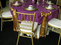 48-inch Round Table: White Solid 108 round, Plum Solid 90 round gathered with six Gold Satin sashes