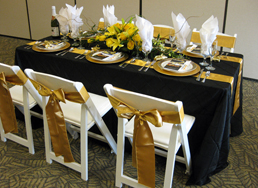6-foot Banquet Table: Black Pintuck 90 x 132, two Gold Satin sashes