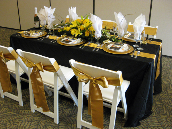 Attractive 6 Foot Banquet Table: Black Pintuck 90 X 132, Two Gold Satin Sashes